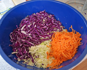 shredded cabbage and carrot ready for coleslaw