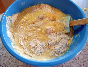 adding mashed banana to sifted flours