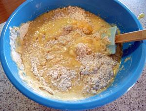 adding mashed banana to sifted flours