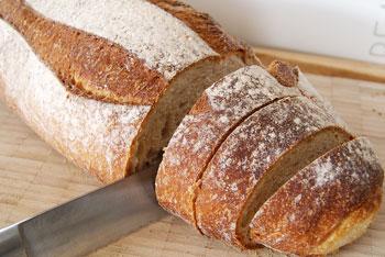 Cutting sourdough loaf for bruschetta