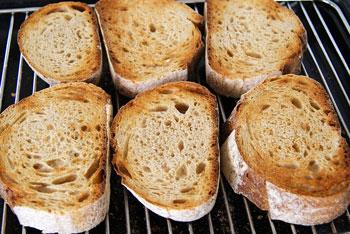 grilling bread slices for bruschetta