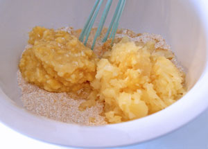adding pineapple and banana to flour mixture