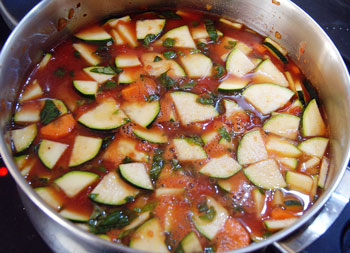 Italian vegetable soup cooking in a pot