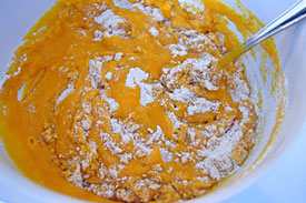 adding pumpkin mixture to flour mixture