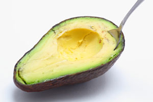 Scooping out avocado flesh