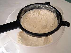 sifting flour for buttermilk pancakes