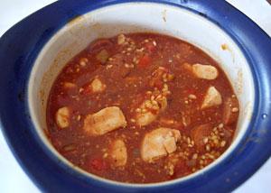 chicken pilaf in casserole dish ready to bake