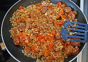 cooking the pepper, chorizo and rice