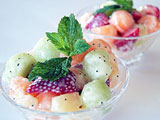 bowl of fruit salad with poppyseed dressing