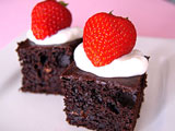 low fat brownies topped with yogurt and strawberries