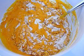 adding pumpkin mixture to flour mixture