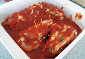 stuffed chicken in pan with sauce3
